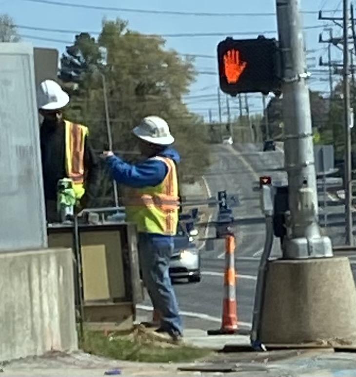 Missouri workers on the job working on street